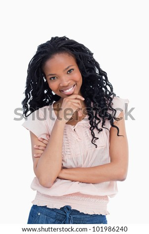 A woman is smiling at the camera against a white background - stock photo