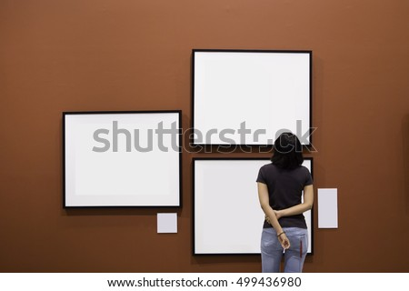 Woman Standing Looking Blank Painting Frames Stock Photo (100% Legal ...