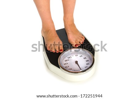 A woman is standing on a weight scale