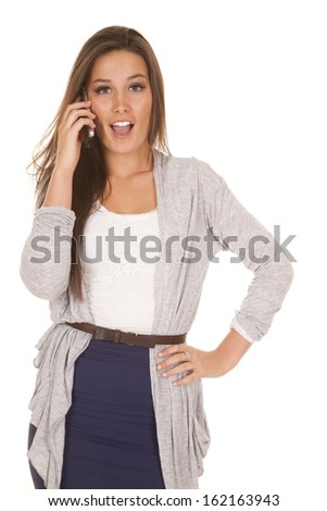 A woman is talking on the phone with a shocked expression.
