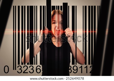 A woman is trapped by a shopping commerce bar code with lines and a red scanner on her face. Use it for a consumerism or security metaphor. - stock photo