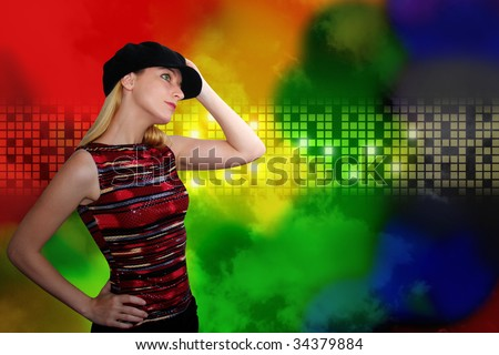A woman is wearing a black hat and is dancing at an entertainment  nightclub. The background has glowing colored, rainbow squares. Add your text in this area or leave it blank.