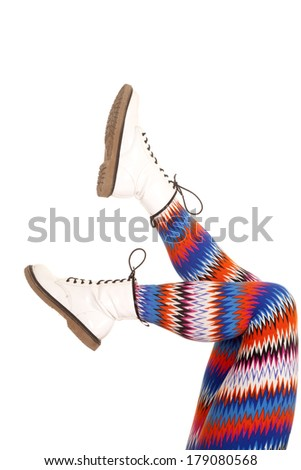 A woman legs in the air in colorful pants. - stock photo