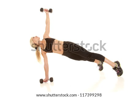 a woman lifting her weight up in the air. - stock photo