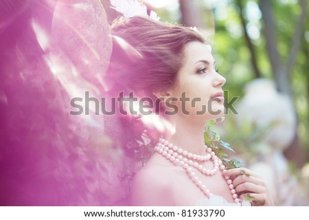 A woman like a princess in an vintage dress in nature - stock photo