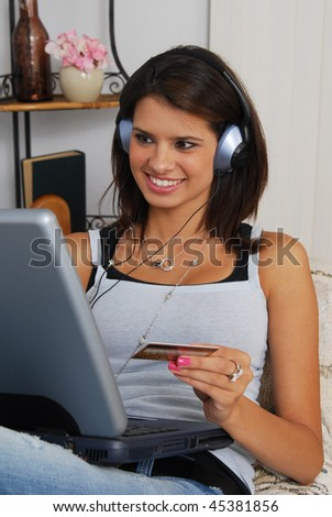 A woman listening to headphones and placing an order on the internet