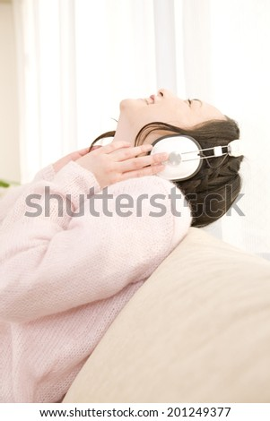 A woman listening to music with her headphones