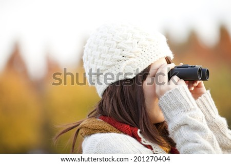 A Woman Looking At A Distant Place Through A Telescope - stock photo