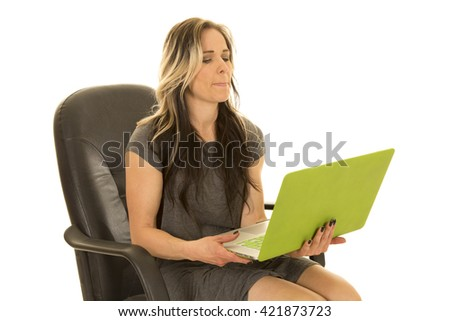 A woman looking at her laptop hoping something will work.