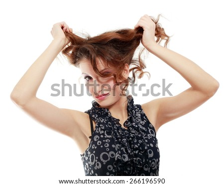 A woman looking at her short bad hair. - stock photo