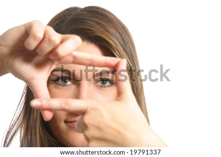 A woman looking threw her fingers finding the angle --better for *WEB USE*