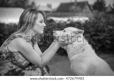 A woman looks at her dog eyes