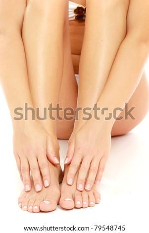 A woman massaging her feet, closeup - stock photo