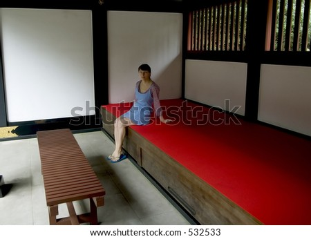 A woman meditating  in japanese temple
