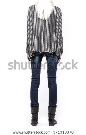 A woman(model, girl, female) stand up wearing grey shirts(sweater), blue denim(jeans, pants, trousers), black leather military boots isolated white at the studio. - stock photo