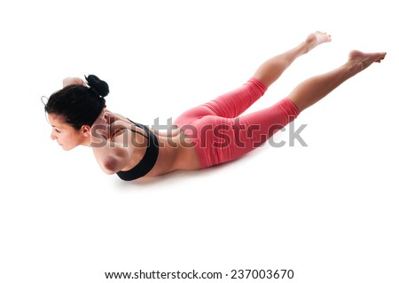 A woman moves into Upward Facing Dog pose, part of a stomach's exercises