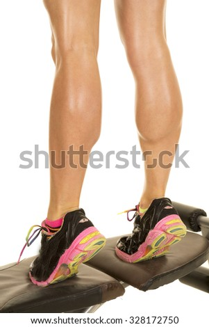 a woman on a bench doing a calf raise.