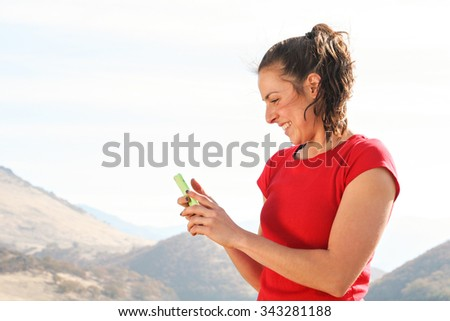 A woman on her phone in the outdoors