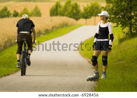 a woman on rollerblades - stock photo