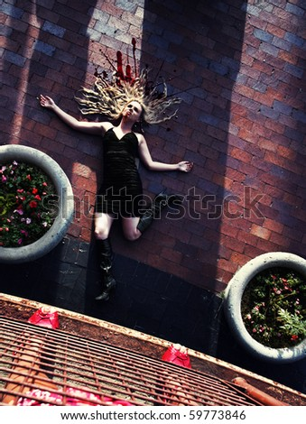 a woman on the ground - stock photo