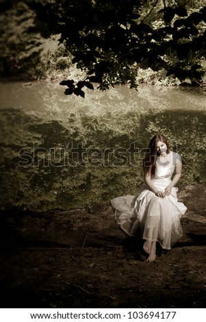 A woman or bride sitting on a log