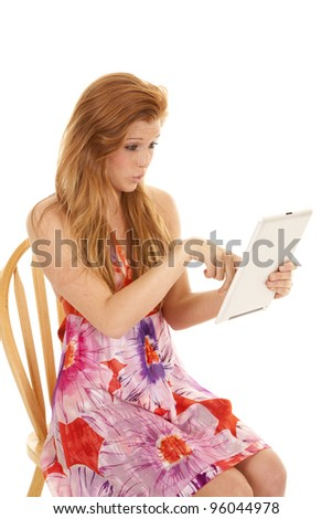 a woman pointing at something on her tablet with a shocked expression.