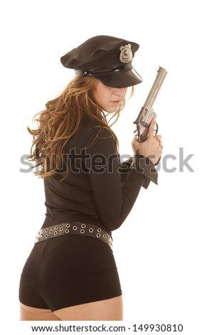 A woman police officer from the back with a gun.