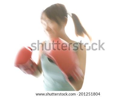 A woman practicing boxing