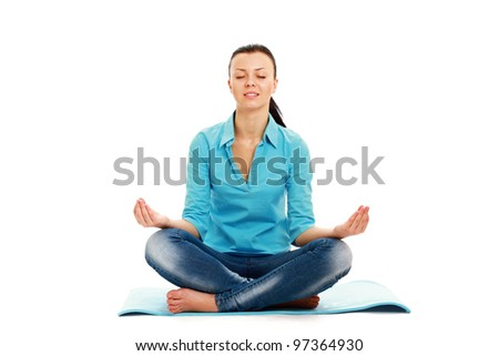 A woman practising yoga on the floor, isolated on white background