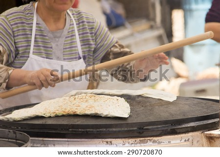 A woman prepares traditional Turkish pastries - gozleme