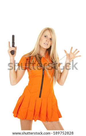 A woman prisoner with her hands up, she is holding on to a weapon. - stock photo