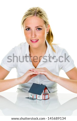 a woman protects your house and home. good and reputable insurance financing calm. - stock photo