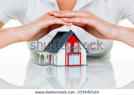 a woman protects your house and home. good insurance and reputable financing calm. - stock photo