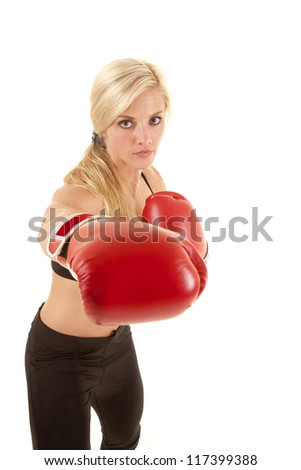 A woman punching at the camera with a serious expression on her face.