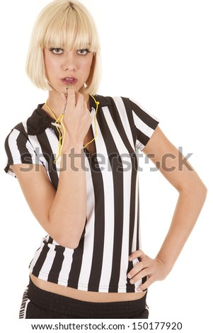 A woman referee getting ready to blow her whistle. - stock photo