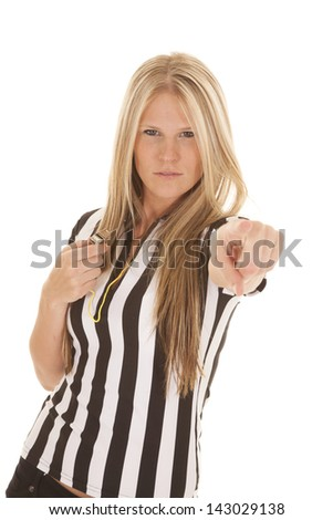 A woman referee with a serious expression on her face holding on to her whistle and pointing with her finger. - stock photo