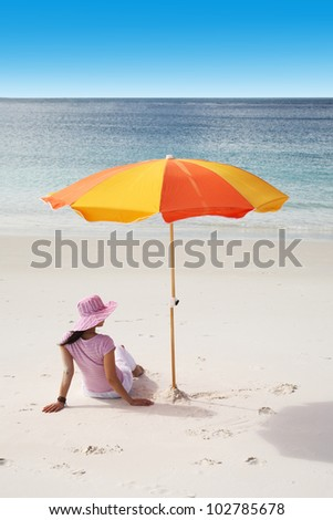 A woman relaxing in a beautiful tropical beach - stock photo