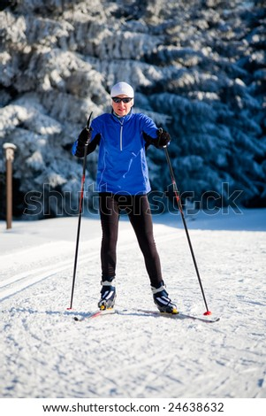 a woman runing cross-country ski. Skate style. - stock photo