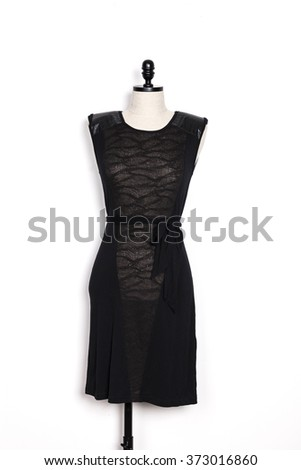 A woman's black t shirts, skirt(one piece) with mannequin on the wall isolated white.