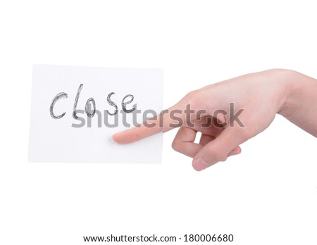 A woman's hand holding a card - stock photo