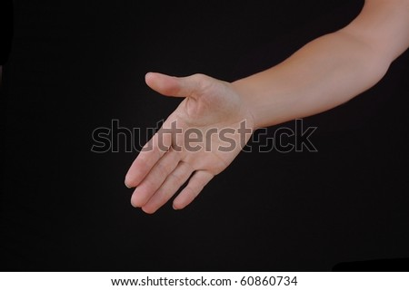 A Woman's Hand Reaching Forward to Shake Hands, Isolated on Black - stock photo