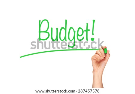 A woman's hand writing the word, Budget, on a clear screen. - stock photo