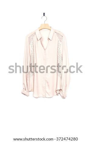 A woman's ivory shirts(blouse) isolated white. - stock photo