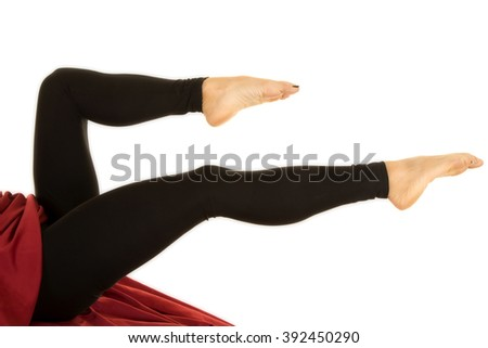 a woman's legs pointed in her black fitted leggings. - stock photo