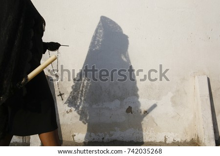 A woman´s shadow with the traditional dress during the Holy Week in Spain