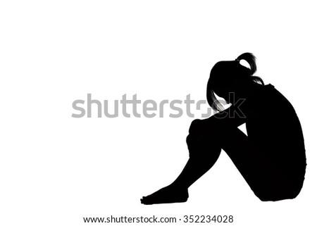 A woman sad depressed sitting along isolated on white background. - stock photo