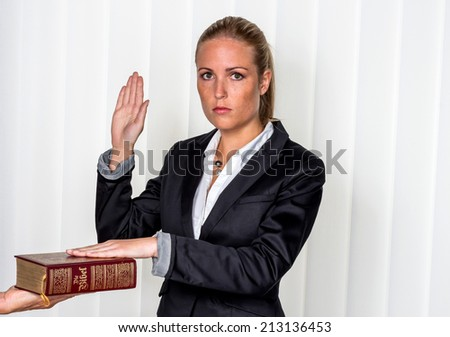 a woman says as a witness in court in a lawsuit. is sworn in and swears on the bible.
