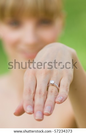 A woman showing an engagement ring