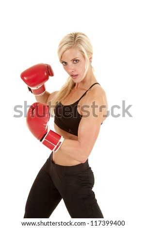 A woman showing her attitude and power by boxing. - stock photo