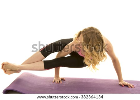 a woman showing off her strength by doing a yoga hold. - stock photo